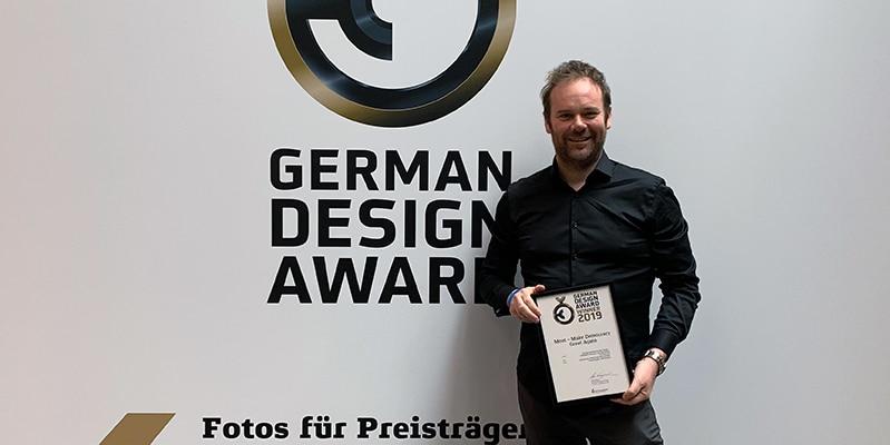 Frank Long collecting Frontend.com's 2019 German Design Award for Excellent Communications Design.